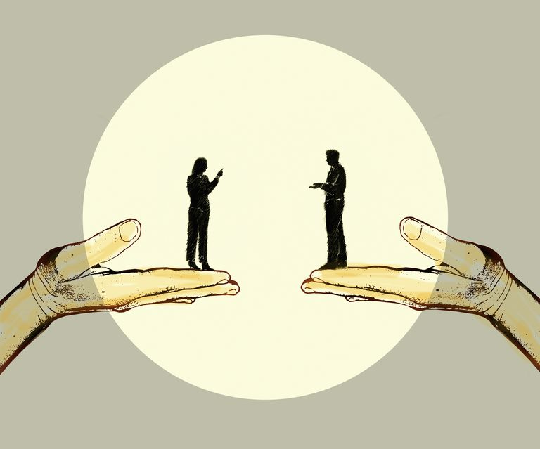 Man and woman discussing standing on top of supporting hands