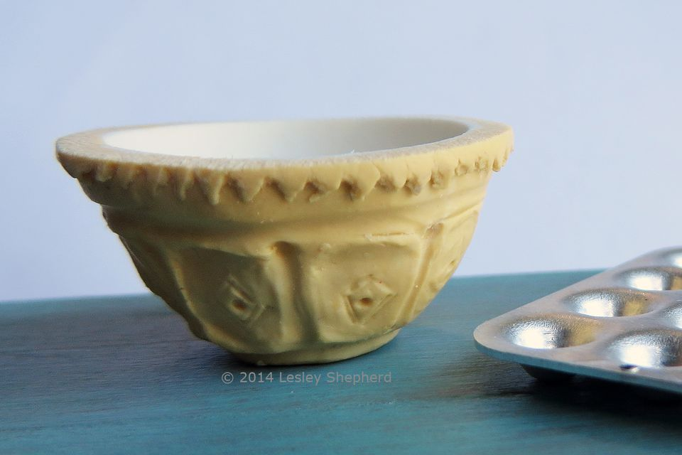 A traditional kitchen mixing bowl made from polymer clay in dollhouse scale.