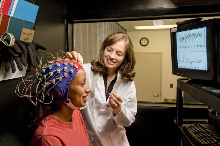 Doctor and patient with electrodes on head