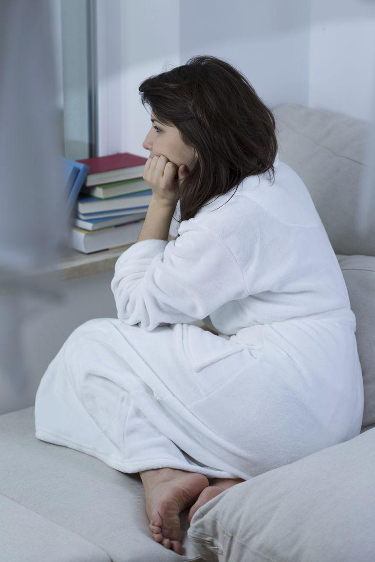 girl in bathrobe thinking
