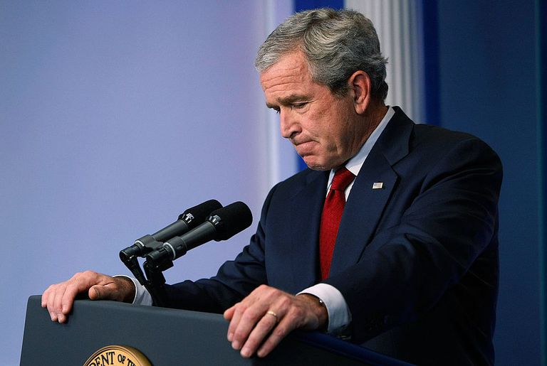 U.S. President George W. Bush looks downward as he listens to a question about the war in Iraq during a press conference July 12, 2007