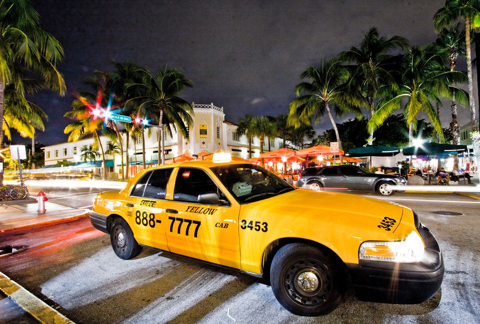 Night Picture of a Yellow Cab parked at Lincoln Road in Miami Beach.