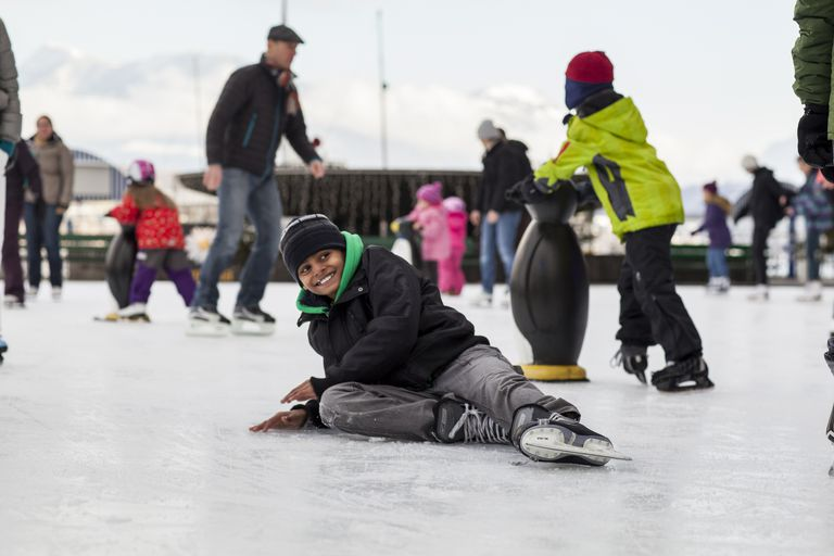 Boy laughing after iceskating fall