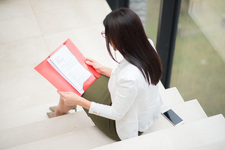 Woman looking at documents