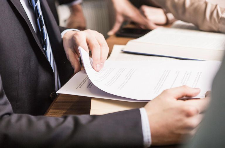 Male lawyer with documents in meeting