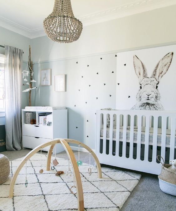Neutral nursery with graphic bunny focal wall