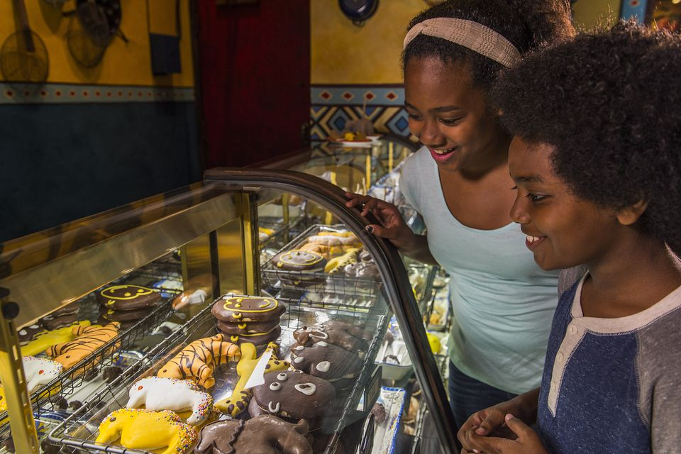 Kids try to decide on sweet treat at Zuri's Sweet Shop at Disney's Animal Kingdom.
