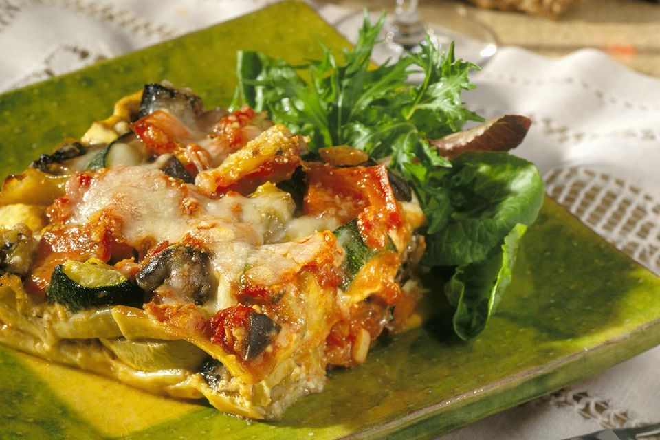 Serving of Vegetable Lasagna with Salad, Glass of Red Wine & Bread
