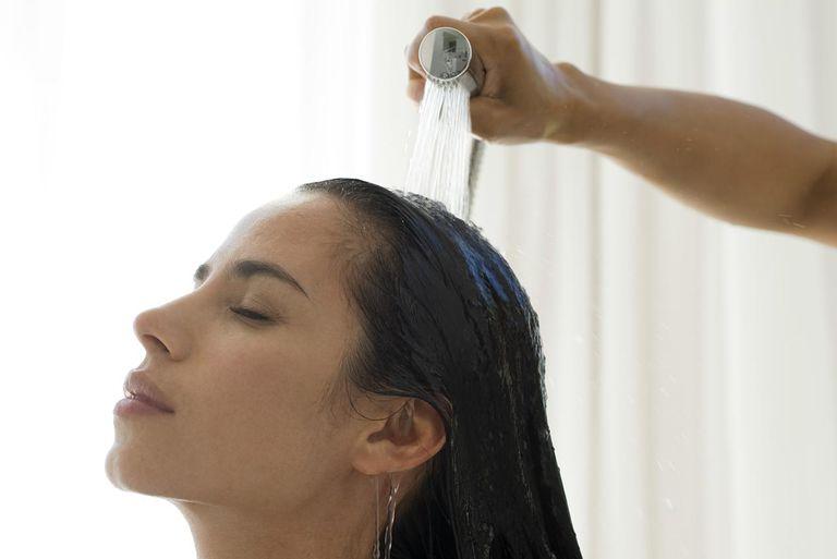 Woman having hair rinsed