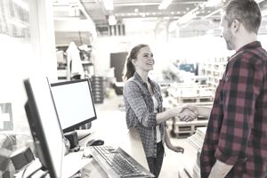 Young employee shaking hand with boss
