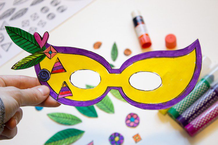19 free mardi gras mask templates for kids and adults a yellow and purple paper mardi gras mask pronofoot35fo Images