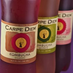 An image of Carpe Diem Classic Kombucha, Quince Kombucha and Cranberry Kombucha in the bottles.