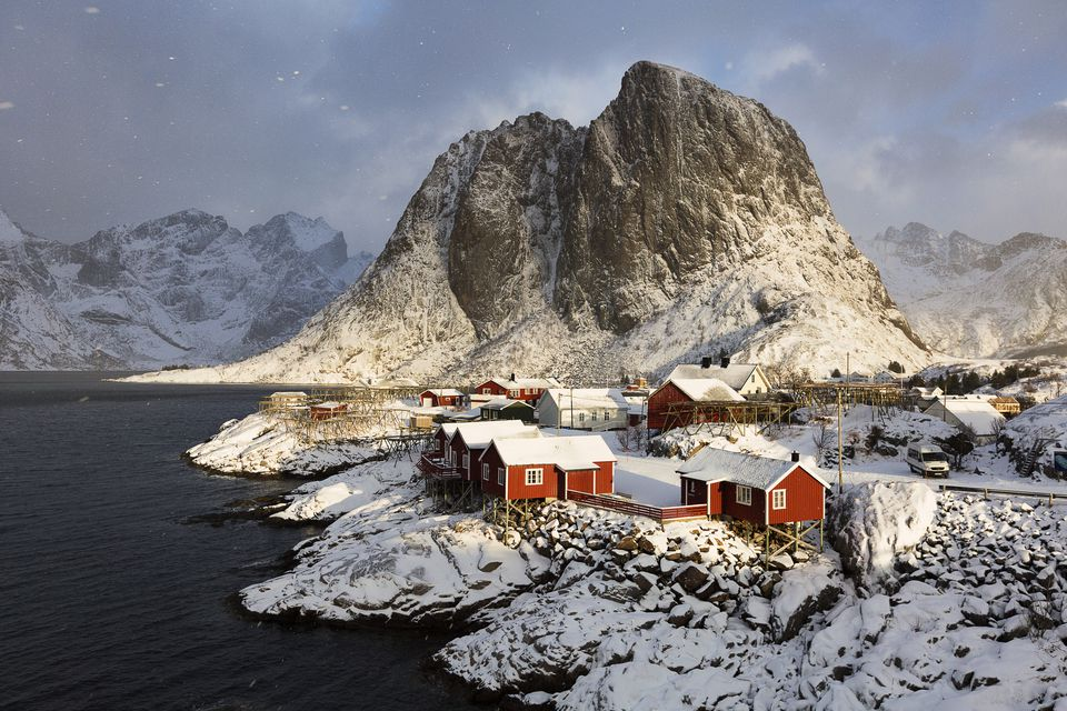 Hamnoy, Norway: A view of the Eliassen Rorbuer cabins as the light starts to disappear from an incoming snowstorm