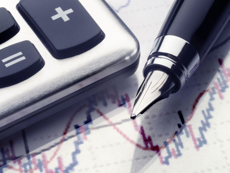 pen and calculator on stock chart