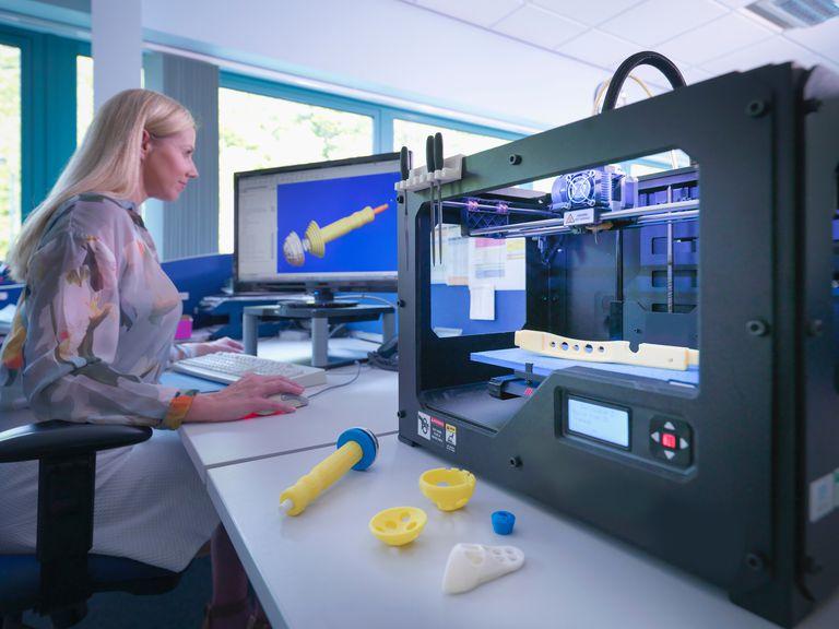 Woman priting 3D model of prosthetic