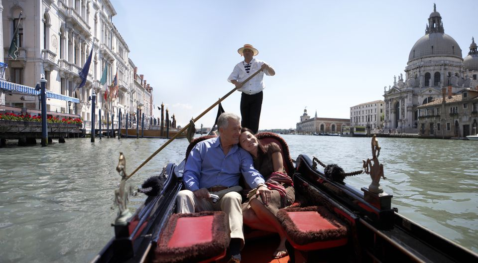 'Italy, Venice, couple riding in godola, woman leaning against man'