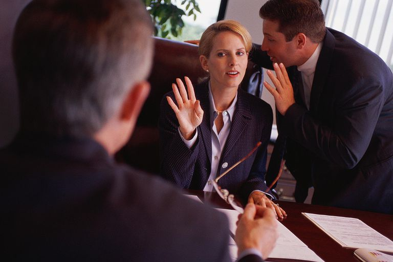 Woman and two men meeting to discuss a negligent hiring lawsuit.