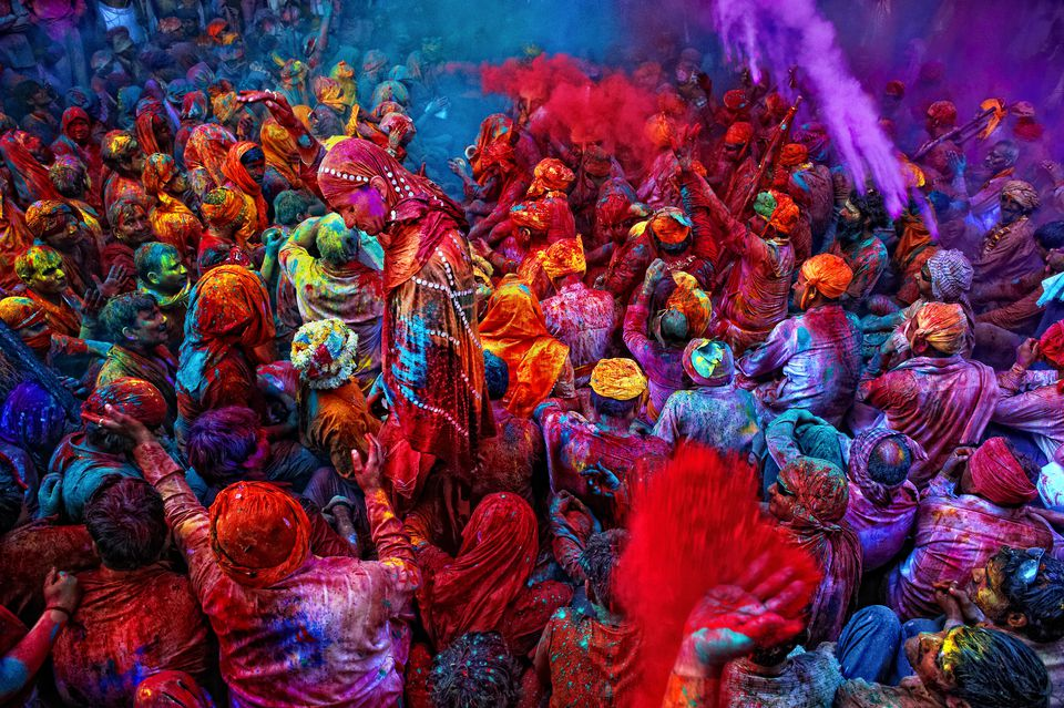 Throwing colors during Holi in India