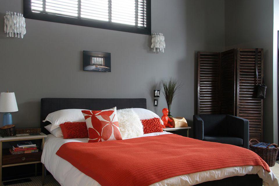 Grey and orange bedroom.
