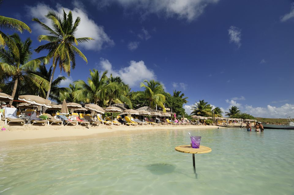 France, Guadeloupe, Saint Martin, Cul de Sac, Pinel Island, table in the water