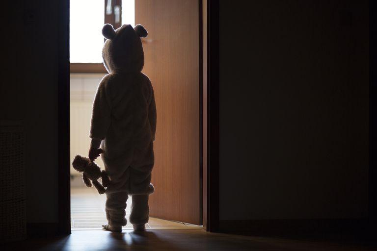 Child in bear costume sleepwalking