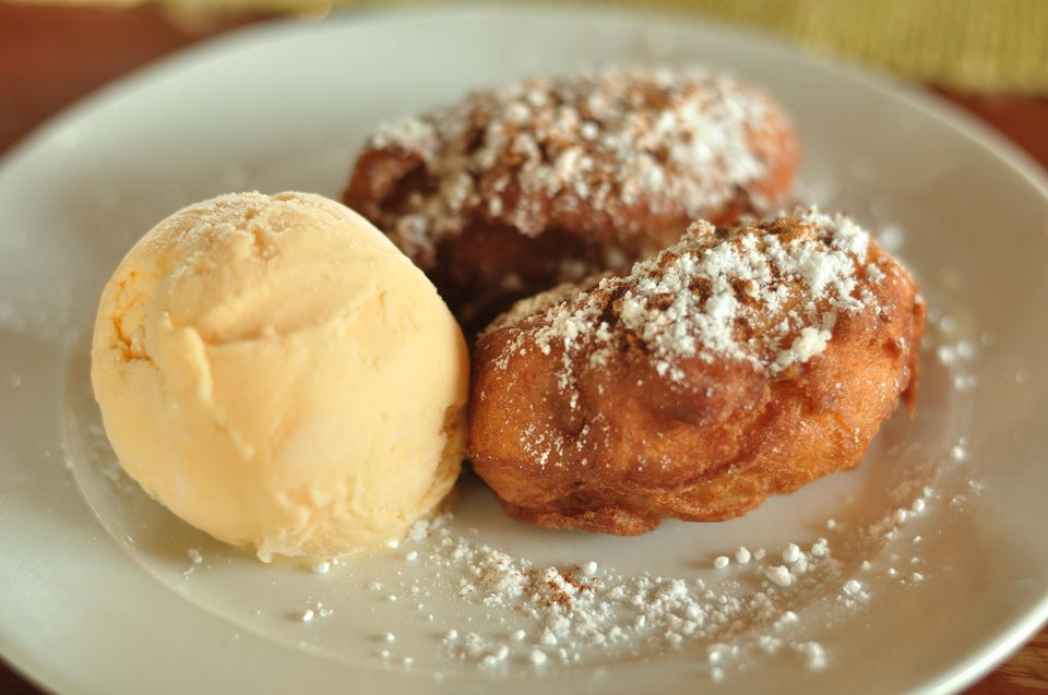 Deep Fried Bananas Served With Ice Cream In Plate