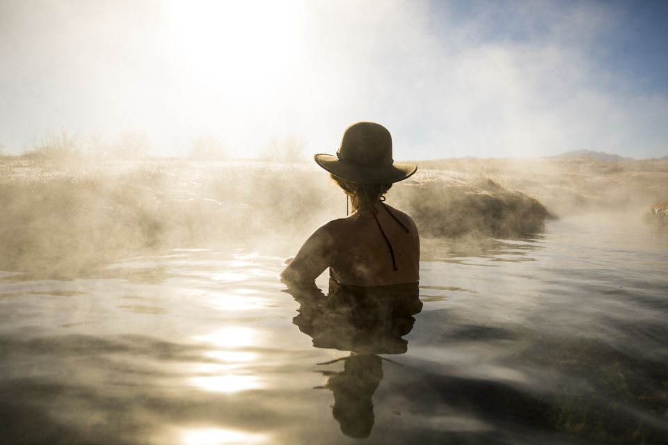 A woman relaxing in a hot spring.
