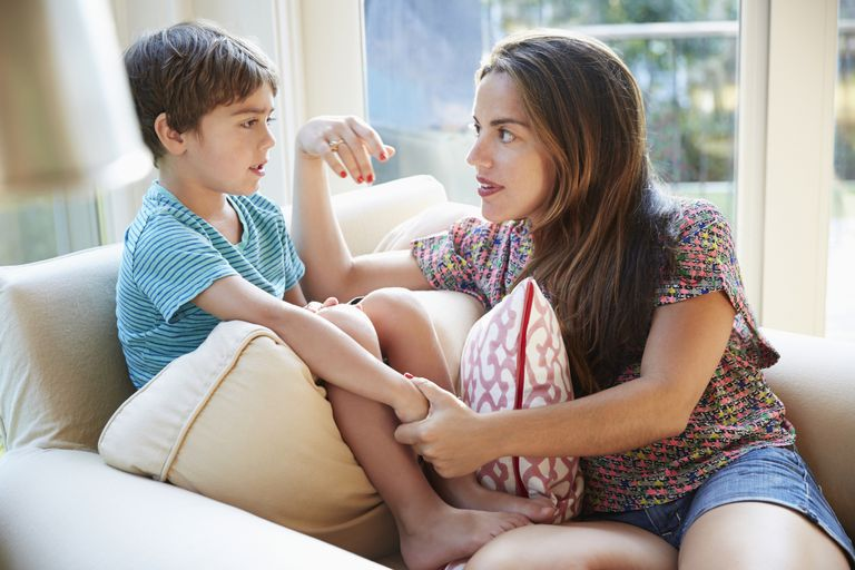 mother talking to young boy