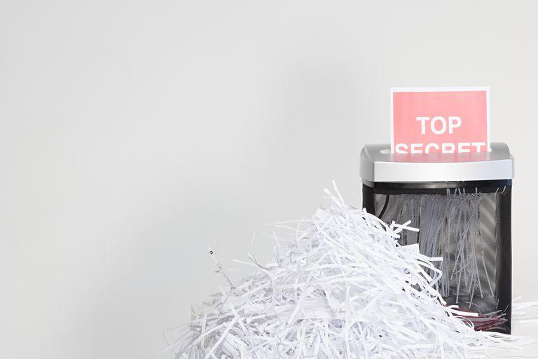 A top secret document being shredded