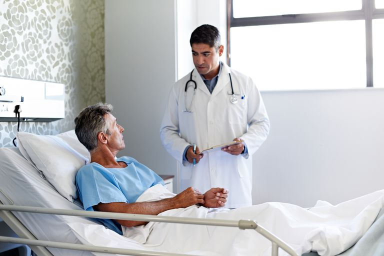 Man and doctor talking in hospital room