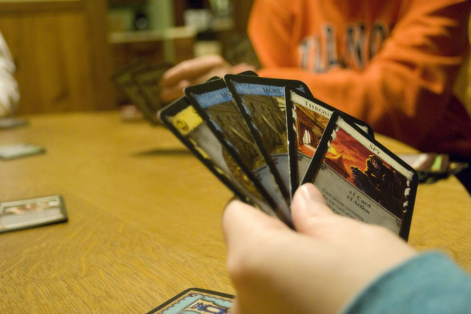 dominion card game player holding cards