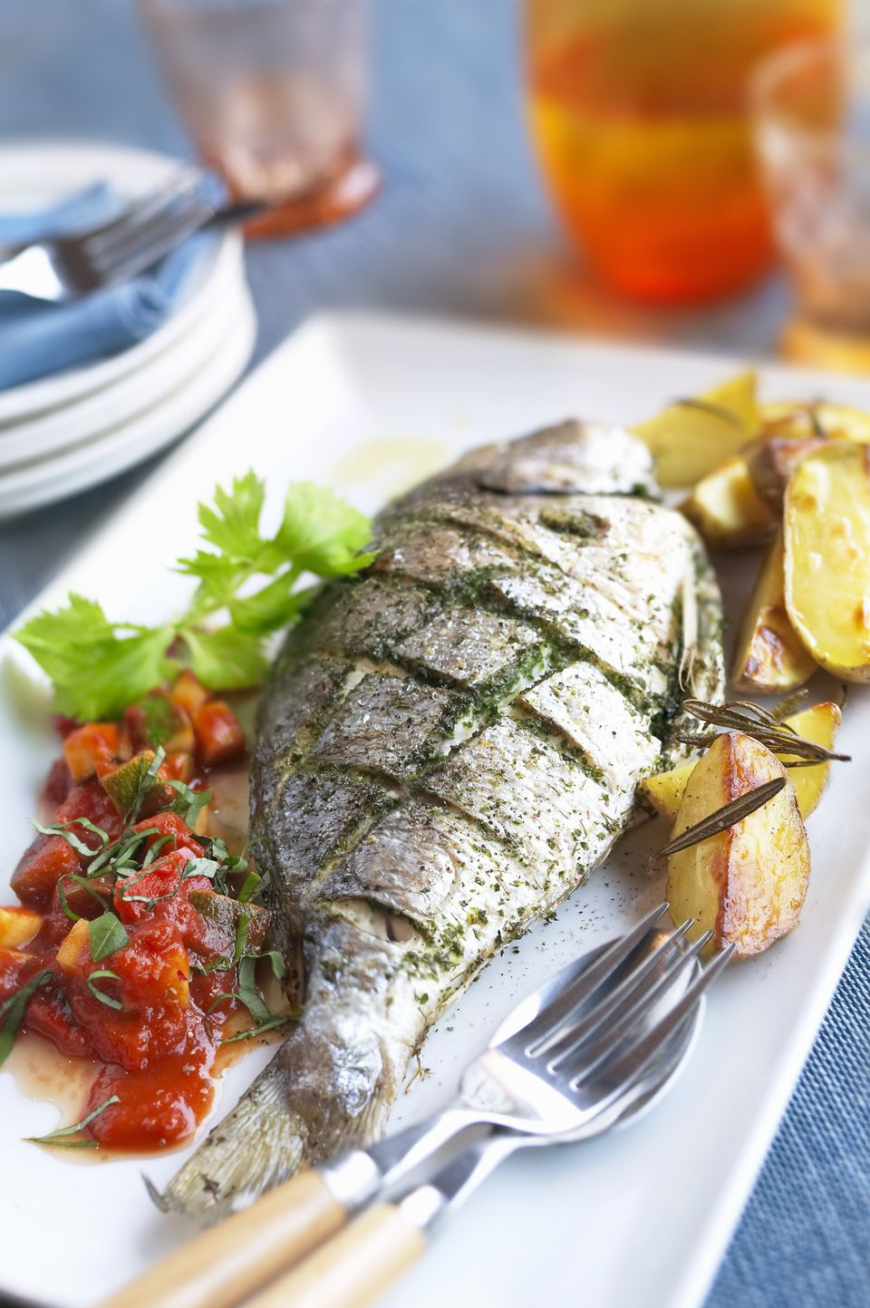 A whole roast fish with rosemary and herbs