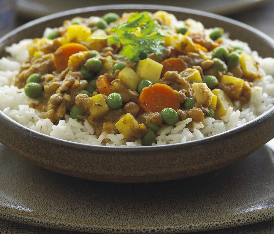 Indian curried veggies: Potatoes, carrots, pease and tomatoes