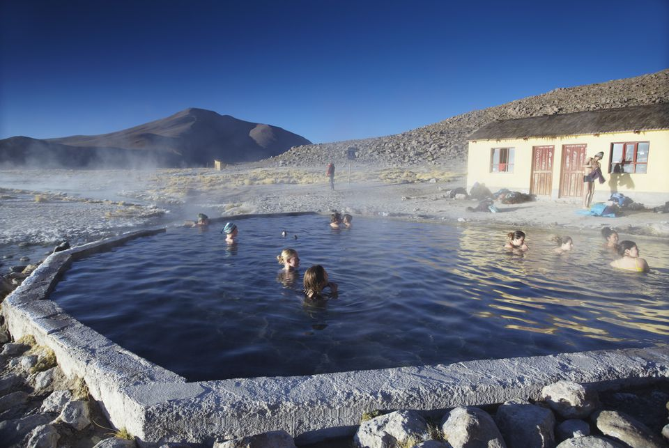 Tourists in hot springs of Termas de Polques on the Altiplano, Potosi Department, Bolivia