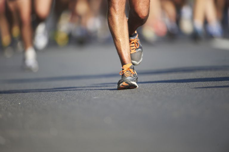 Legs and feet of joggers, running a marathon