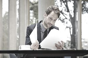 A businessman reading documents at a desk
