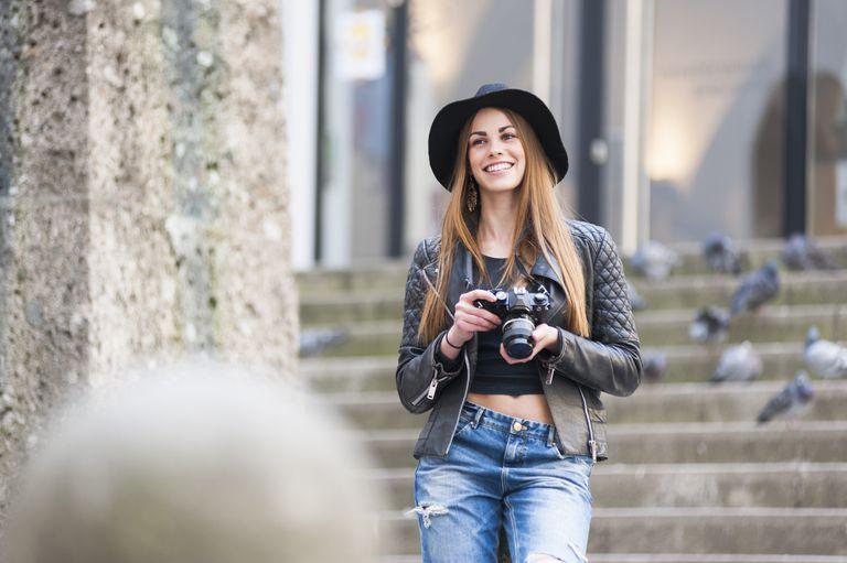 Stylish young female photographer