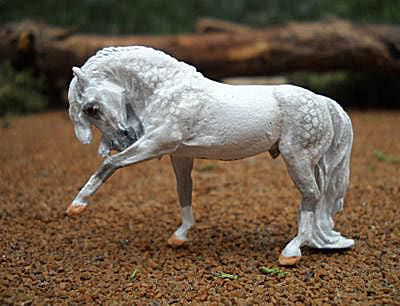 Micro mini model horse on a natural footing.