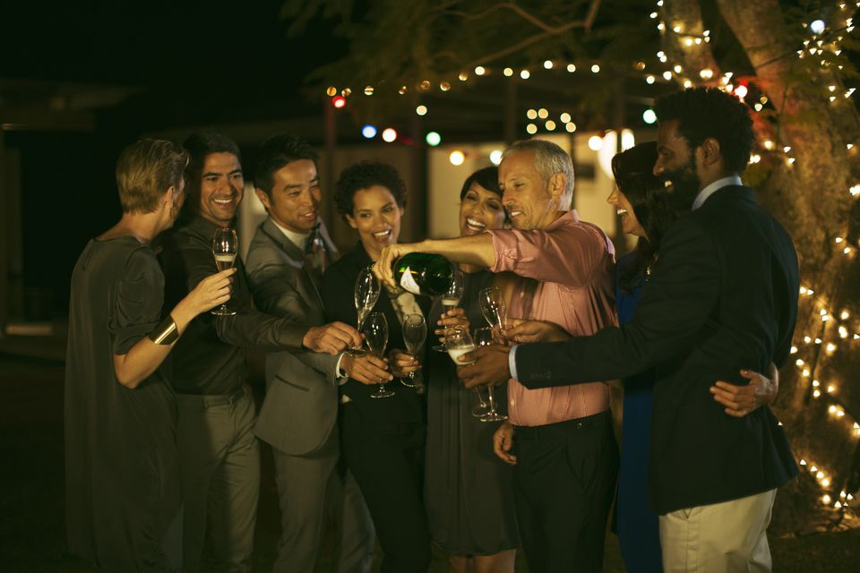 Friends celebrating with champagne at party