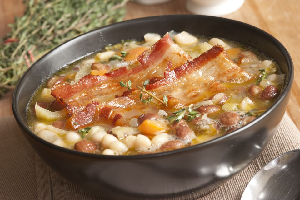 An image of a bowl of Tuscan soup with bacon