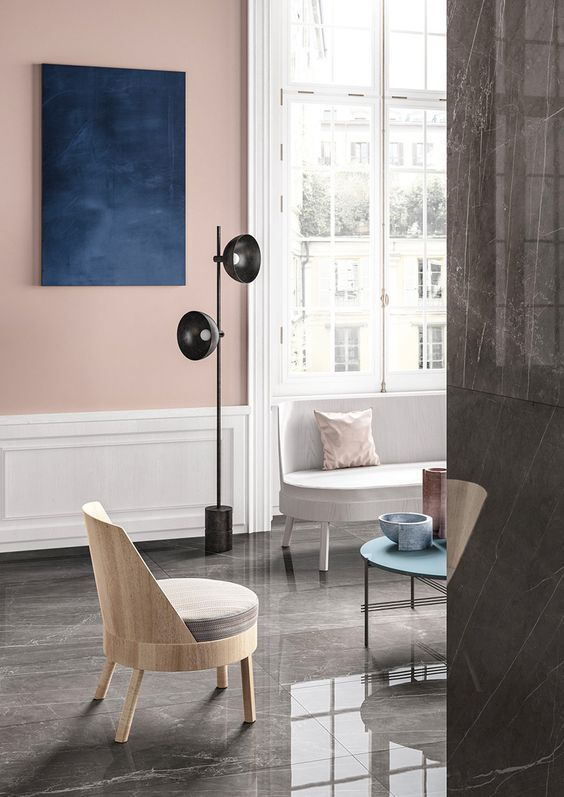 Modern living room with pale pink feature wall