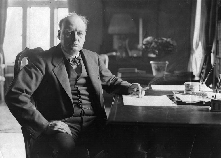 Winston Churchill (1874 - 1965) seated at his desk at Chartwell.