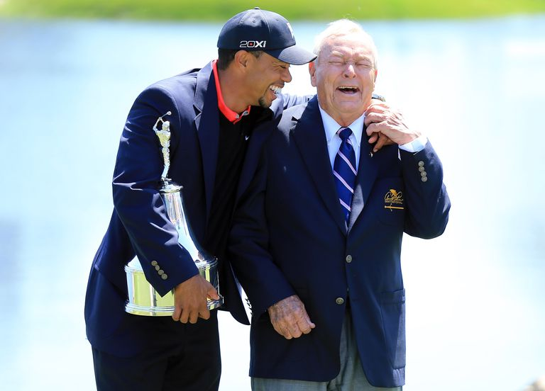 Tiger Woods and Arnold Palmer laughing