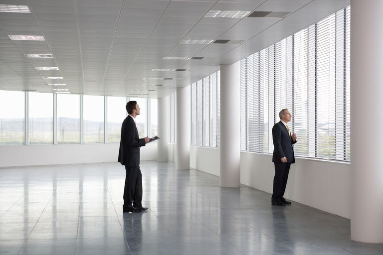 Commercial Real Estate Agent  Career Considerations Letting Agent Showing Businessman Around Empty Office