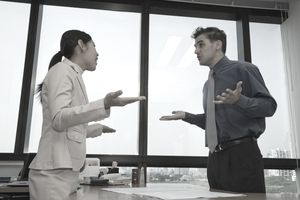male and female business people arguing