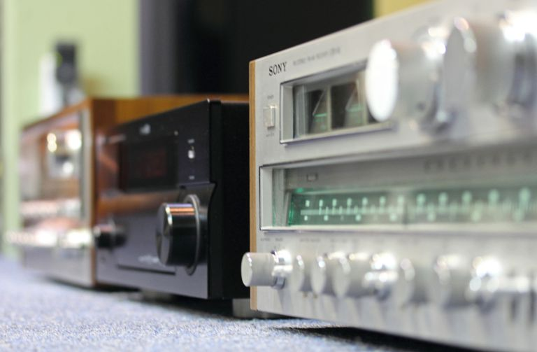 Three vintage receivers photographed at an angle