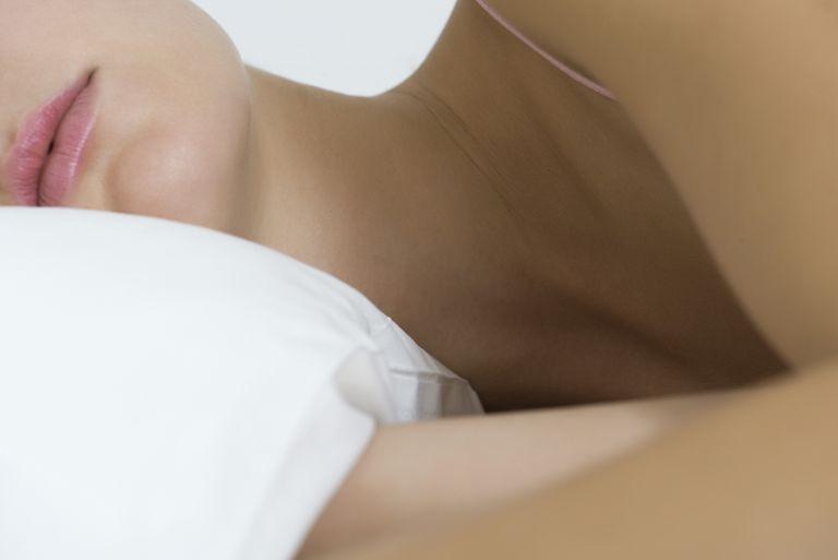 Woman lying on pillow