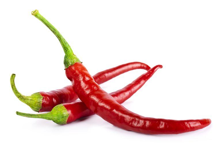 The red color of chili peppers doesn't really indicate high heat. Some green peppers are much hotter on the Scoville scale.