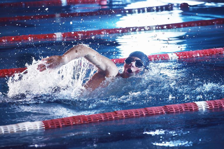 A man taking breath during swimming freestyle