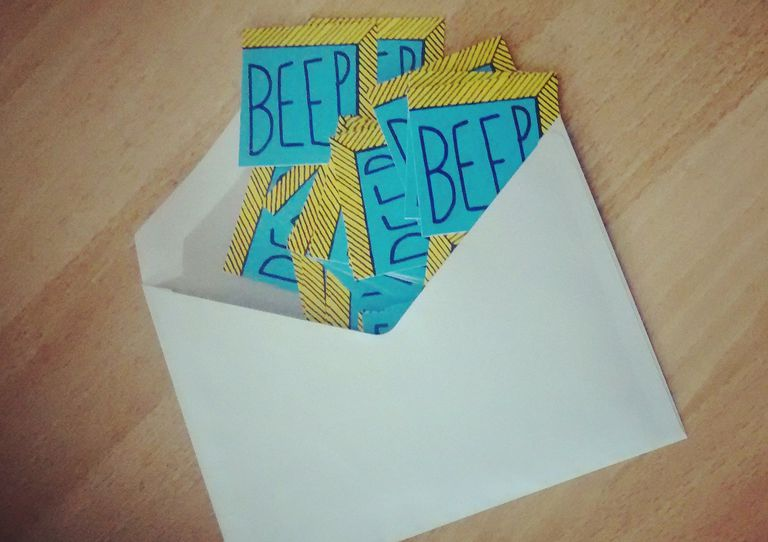 High Angle View Of Beep Text On Paper In Envelope